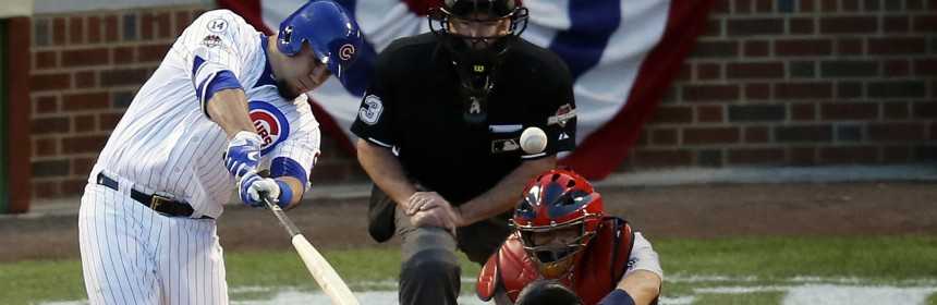 Chicago Cubs' Kyle Schwarber (12) hits a home run against the St. Louis Cardinals during the second inning of Game 3 in baseball's National League Division Series, Monday, Oct. 12, 2015, in Chicago. (AP Photo/Charles Rex Arbogast)